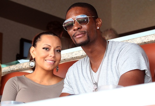 Chris Bosch and pregnant wife Adrienne Williams watch the Miami Dolphins.