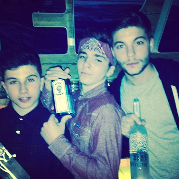 madonna-causes-controversy-for-posting-a-picture-of-her-son-rocco-13-holding-a-liquor-bottle-news-0106-1