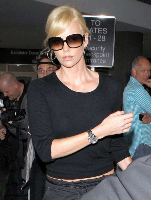 Charlize Theron Arriving For A Flight At LAX