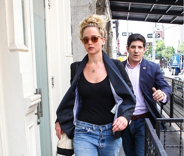 Jennifer Lawrence was back to business as she was spotted apartment hunting in the Tribeca neighbourhood of New York on Monday. Photo by Warner AZ/AKM - GSI