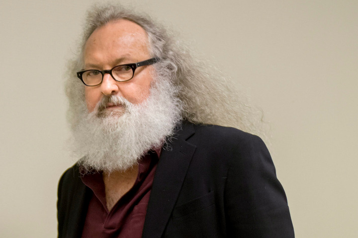 """Actor Randy Quaid arrives at his Immigration and Refugee Board hearing in Montreal, Thursday, Oct. 8, 2015. Quaid said in an interview that he could be deported from Canada next week and that he would like to resolve his legal issues in California and """"move on with my life."""" The actor and his Canadian wife fled the U.S. in 2010, saying they were victims of persecution. (Peter McCabe/The Canadian Press via AP)"""