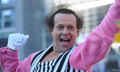 Image #: 25760260 epa03969032 US fitness personality Richard Simmons, rides a float in the Macy's 87th Annual Thanksgiving Day Parade in New York City, USA, 28 November 2013. The annual parade, which began in 1924, features giant balloons of characters from popular culture floating above the streets of Manhattan. EPA/PETER FOLEY /LANDOV